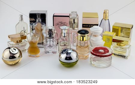 QUEENSTOWN SOUTH AFRICA - 04 December 2016 - Illustrative editorial image of assorted famous name new and vintage perfumes / eau de toilette / frangrances bottles isolated on white background.