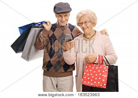 Seniors with shopping bags looking at a mobile phone isolated on white background