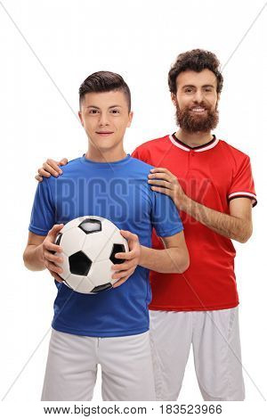 Proud father with his son dressed in sport jerseys looking at the camera isolated on white background