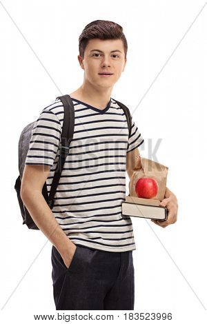 Teenage student holding books and a snack isolated on white background