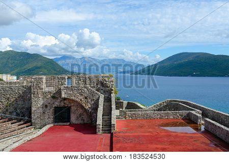 Fortress Kanli-Kula (Bloody Tower) against backdrop of Bay of Kotor and mountains Herceg Novi Montenegro