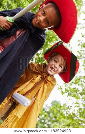 Two young children in theater play with pirates costumes
