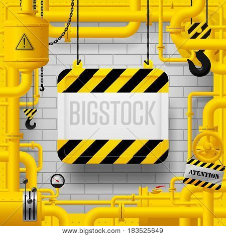 Yellow gas pipes and suspended sign with yellow and black stripes. Industrial frame and background