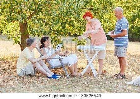 Seniors relaxing at the park wtih water and coffee