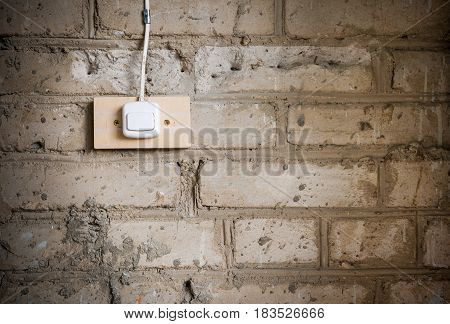 Grunge Background. Close-up Part Of Old Dirty Brick Wall And Electric Switch Attached To It.