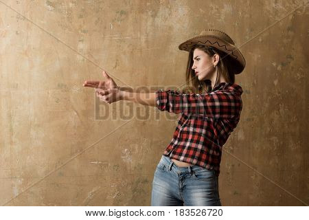 Pretty Girl In Stylish Cowboy Hat Showing Finger Gun