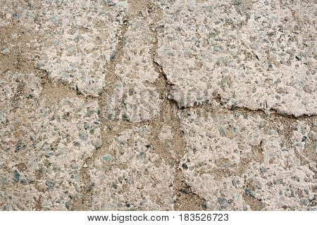 Stone Background. Part Of Pavement Made Of Concrete With Small Pebbles And Sand, Hammered Into Crack