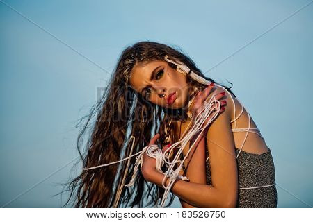 Girl With Long Fashionable Indie Hairstyle On Blue Sky