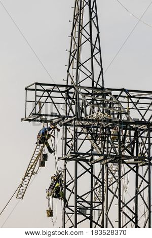 working on an electricity pylon