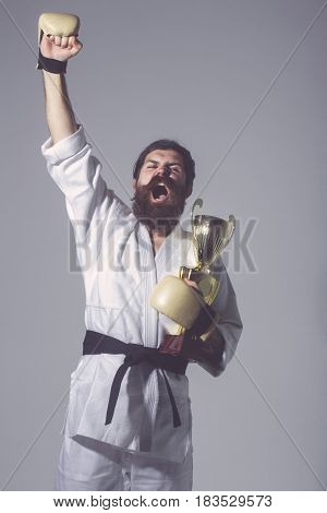 Bearded Happy Karate Man In Kimono, Boxing Gloves, Champion Cup