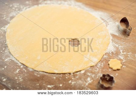 Close Up View Of Raw Dough And Cookie Cutters On Table