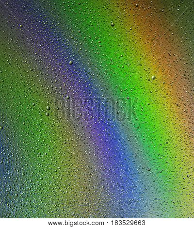Abstractt. Water drops on a rainbow background.