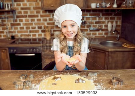 Girl Holding Raw Heart Shaped Dough For Cookie