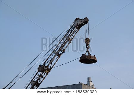 Slavynka Russia - April 14th 2017: Port Slavynka an arrow of the port crane with the electromagnetic loading device against the sky.