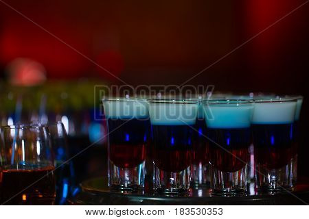 Cocktail Colorful Background In Night Club On Bar Table Top