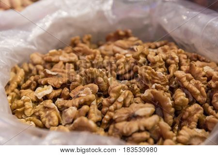 Walnuts without shell in a bag, close-up