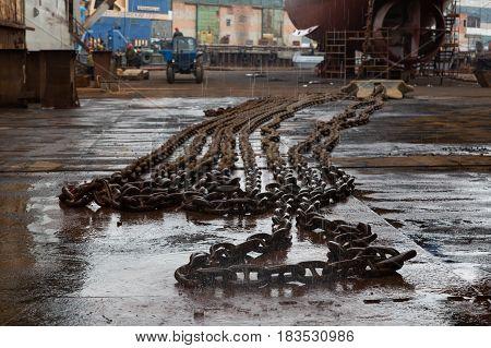Slavynka Russia - April 21th 2017: Port Slavynka ship-repair factory sea ship-repair dock with a chain and an anchor on a deck.