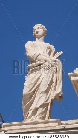 ROME, ITALY - SEPTEMBER 02: St. Thecla, colonnade of St. Peters Basilica. Papal Basilica of St. Peter in Vatican, the world largest church, is the center of Christianity in Rome, on September 02, 2016