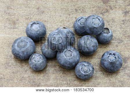 fresh blueberries on a metal tray background