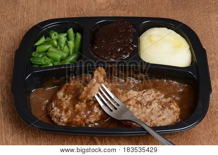 salisbury steak tv dinner with a fork