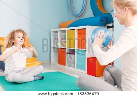 Physhiotherapist Playing Ball With Patient