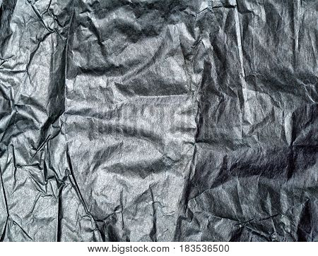 gray wrinkled paper gray background.  crumpled paper