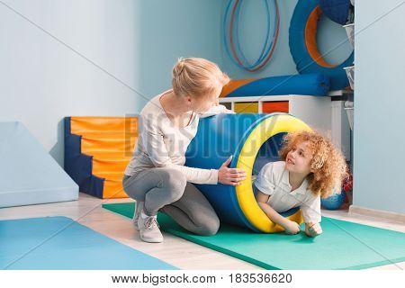 Boy Having Fun In Tunnel