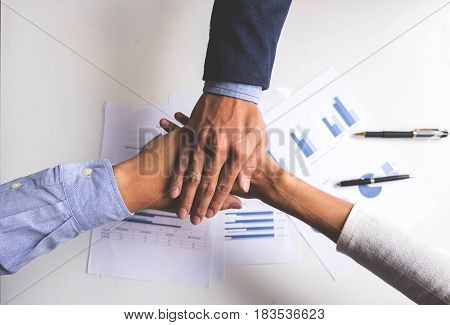 Image of business Concept of Teamwork people joining hands.