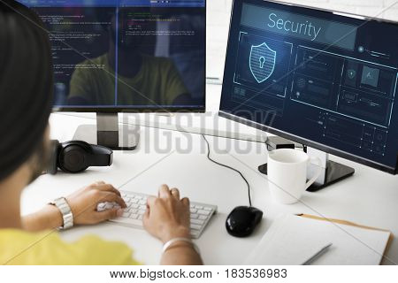Man working on computer network graphic overlay