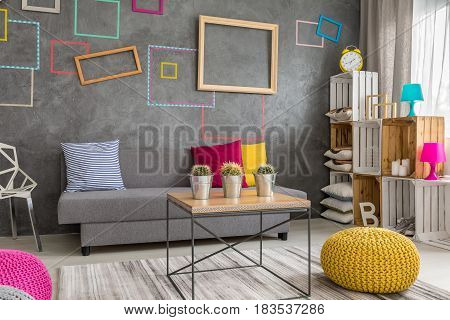Grey Apartment With Wall Frames