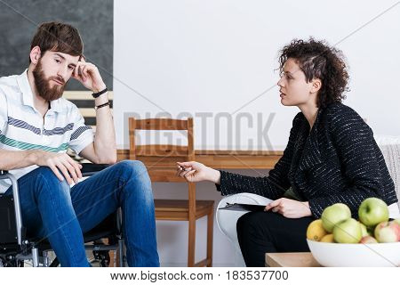 Disabled Man With Young Psychotherapist