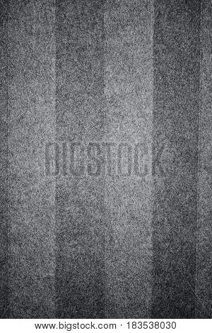 Closeup of folded gray felt background texture.