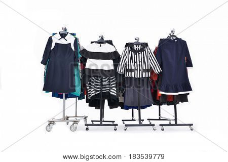 Set of different clothes for females on four hanging