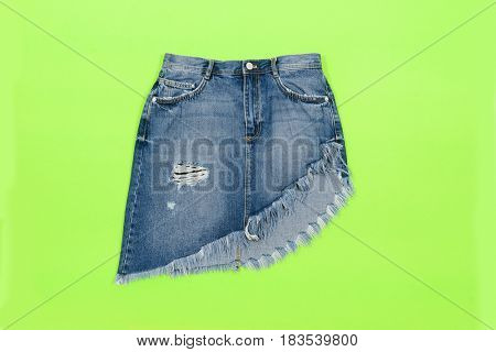 Blue denim skirt,shorts isolated on green background