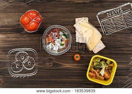 My daily meal. Top view of vegetable salad standing on the table near cheese sandwich and doughnuts