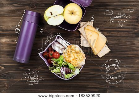 Healthy eating habits. Top view of thermos lying on the table near salad bowl and cheese sandwich