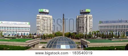 ALMATY KAZAKHSTAN - APRIL 26 2017: Panoramic view of the Republic Square and Monument of Independence of Kazakhstan. Monument was inaugurated on Republic Square December 16 1996.