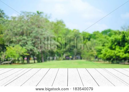 Empty white table perspective wood over blur trees with bokeh background product display montage background