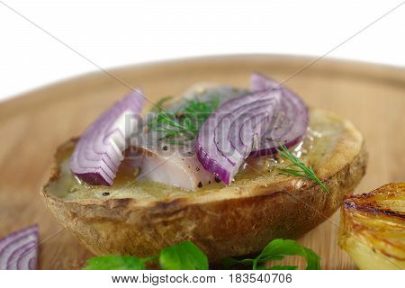 appetizing herring fillet with potato close up