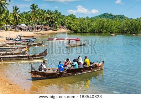 Ambatozavavy Nosy Be Madagascar - December 19 2015: Traditional wood pirogue with outrigger waiting for passengers in the fishing Ambatozavavy village on the Nosy Be island Madagascar.
