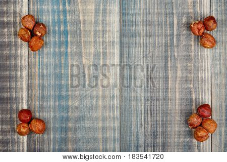 Four Heaps Of Nuts Lie On Wooden Table