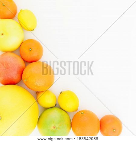 Frame of fresh lemon, orange, mandarin, grapefruit, sweetie and big pomelo on white background. Flat lay, top view.