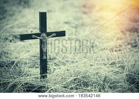 Old wooden Orthodox cross in cracked dry earth. Religion - Christianity. The division of churches.