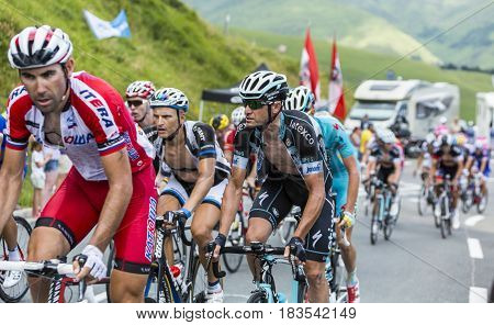 Col de PeyresourdeFrance- July 23 2014: The Italian cyclist Alessandro Petacchi of Omega Pharma-Quick-Step Team riding in the peloton (gruppetto) on the road to Col de Peyresourde in Pyrenees Mountains during the stage 17 of Le Tour de France on 23 July 2