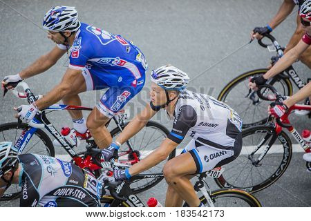 Col de PeyresourdeFrance- July 23 2014: The German cyclist Marcel Kittel of Giant-Shimano Team riding in the peloton (gruppetto) on the road to Col de Peyresourde in Pyrenees Mountains during the stage 17 of Le Tour de France on 23 July 2014.