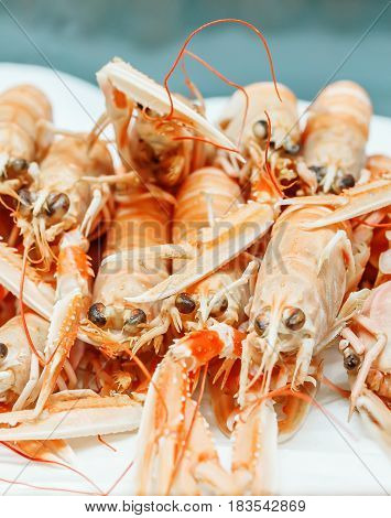 Fresh Lobsters On Ice For Sale At Market. Selective Focus On The Center Lobster.
