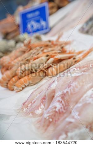 Fresh Cod Fillet And Lobsters On Ice For Sale At Market