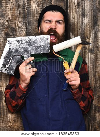 Bearded Builder Man Holding Various Building Tools With Satisfied Face