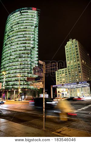 BERLIN GERMANY - APRIL 6: Skyscrapers in Potsdamer platz at night in Berlin on April 6 2017 in Berlin