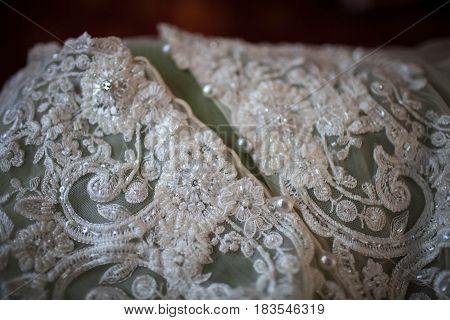 white lace fabric handmade for wedding dress close-up